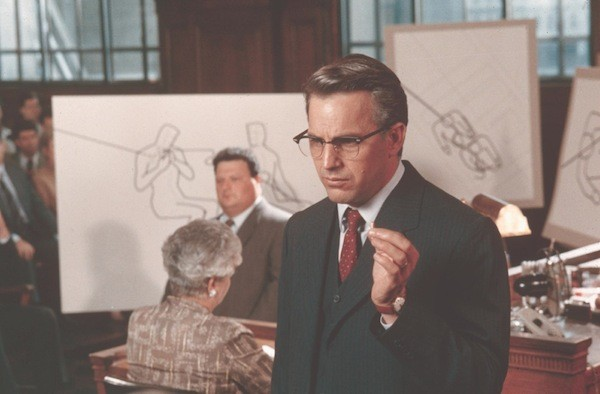 Kevin Costner and Wayne Knight (background) in JFK (Photo: Warner Bros.)