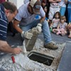 Large crowd shows up for time capsule opening, finds box full of sludge