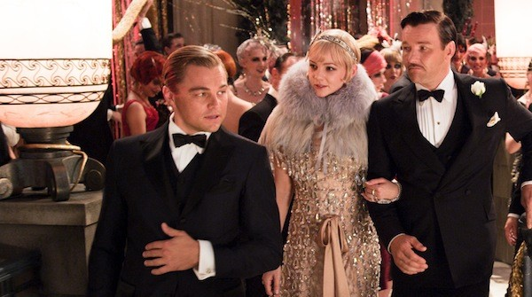 LIFESTYLES OF THE RICH AND FAMOUS: Jay Gatsby (Leonardo DiCaprio, left) provides Daisy (Carey Mulligan) and Tom (Joel Edgerton) with a tour in The Great Gatsby. (Photo: Warner Bros.)