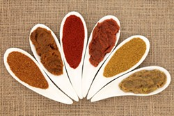 Locavore fanatics might faint at the writer's habit of seasoning local foods with far-flung spices.