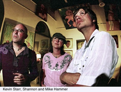 LOOK, UP IN THE SKY: Kevin Starr, the man behind the funky fresh gallery Kevin Starr Art Studio (left), is joined by patrons Shannon and Mike Hammer at an exhibition for artist Kelly Carbon -- which was held at the studio last Saturday. For more info, check out www.kellycarbon.com and www.kevinstarrartstudio.com. - CHRIS RADOK