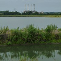 Looking across one of the two unlined, high-hazard coal ash ponds at Duke Energy's Riverbend coal plant. The pond was built in 1957, covers over 40 surface acres and is 80-feet deep.
