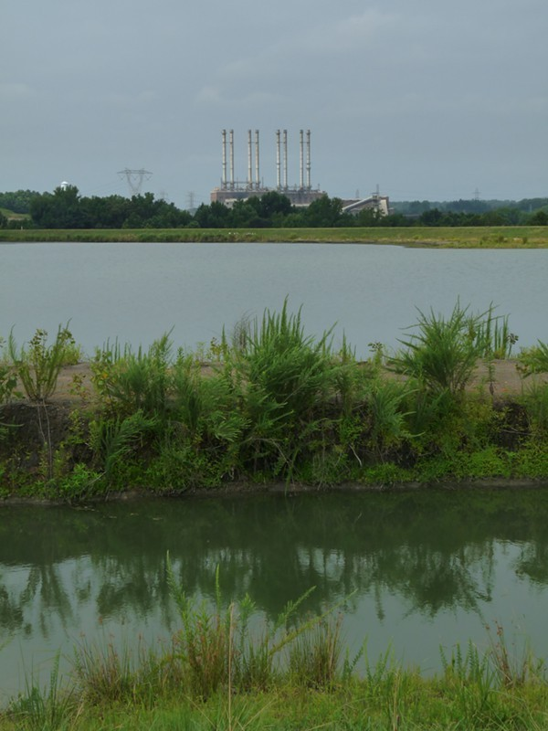 Looking across one of the two unlined, high-hazard coal ash ponds at Duke Energys Riverbend coal plant. The pond was built in 1957, covers over 40 surface acres and is 80-feet deep.