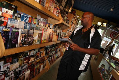 LOOKING FOR HEROES: Customer Rod Joyner peruses the aisles. - CATALINA KULCZAR