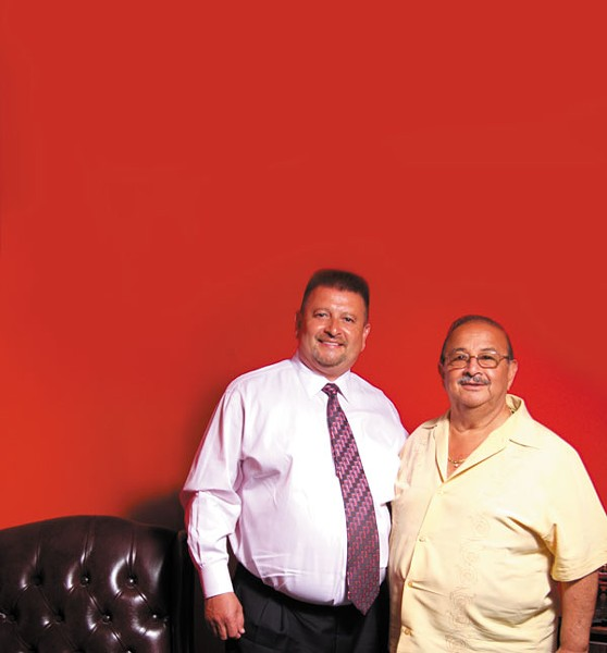 Louis Romero and his father, Carlos Romero. (Photo by Natrice Bullard)