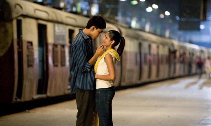 LOVE ON TRACK: Jamal (Dev Patel) and Latika (Freida Pinto) in Slumdog Millionaire. - FOX SEARCHLIGHT