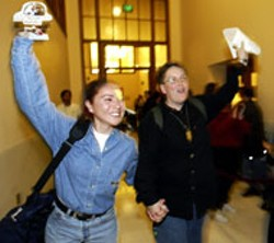 AFP/GETTY IMAGES - Lupe Garcia and Doneen Ross cheer after receiving - their marriage license