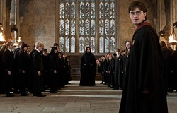 WARNER BROS. - MAGIC: THE GATHERING: Severus Snape (Alan Rickman, center background) and Harry (Daniel Radcliffe, front right) settle their affairs in Harry Potter and the Deathly Hallows — Part 2.