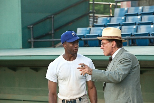 MANAGEMENT TALKS TO TALENT: Brooklyn Dodgers general manager Branch Rickey (Harrison Ford, right) strategizes with baseball player Jackie Robinson (Chadwick Boseman) in 42. (Photo: Warner Bros.)