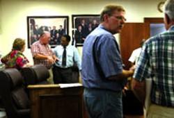 JIM STAWNIAK - Marshall County official Eddie Dixon, rear in blue shirt.