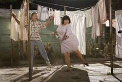 DAVID JAMES / NEW LINE CINEMA - MEET THE PARENTS: Tracy's folks Wilbur Turnblad (Christopher Walken) and Edna (John Travolta) shimmy among the sheets in Hairspray