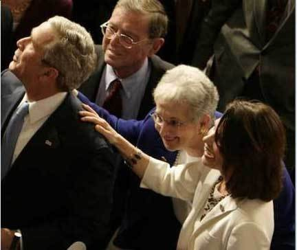 Michele Bachmann (right) and fellow incoherent Dubya worshipper Rep. Virginia Foxx, touch the garment of their Annointed One