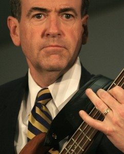 Mike Huckabee and his bass. (Thanks to Aaron Webb for the photo.)