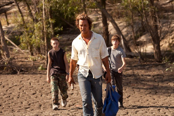 MUD IS THICKER THAN WATER: Neckbone (Jacob Lofland), Mud (Matthew McConaughey) and Ellis (Tye Sheridan) search for ways to get a land-bound boat to the river in Mud. (Photo: Roadside Attractions)