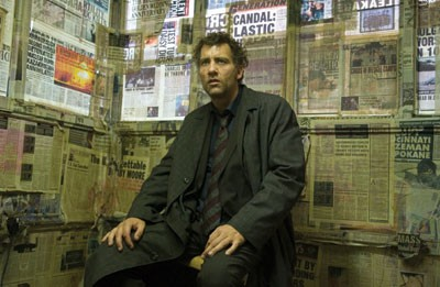 NEWS OF THE DAY Theo (Clive Owen) follows the paper trail in Children of Men. - JAAP BUITENDIJK / UNIVERSAL