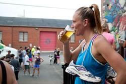 MELISSA OYLER - NoDa resident Stacia Caliano enjoys a NoDajito after a 3-mile run.