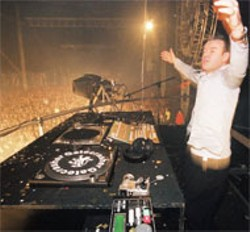 PAUL HARNESS - Oakenfold in his prime, playing to the massive crowd - gathered at the 1999 Gatecrasher Festival in England.