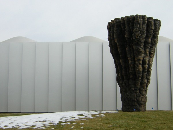 """Ogromna"" — sculpture by Ursula von Rydingsvard, a typical new facade in the background. Images by Manoj Kesavan."