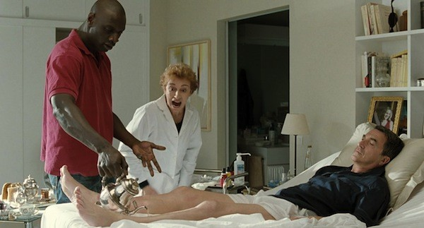 Omar Sy (left) and François Cluzet (flat) in The Intouchables (Photo: The Weinstein Co.)