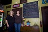 <p>ON BOARD: Lori Pearson (left) and Lisa Burris next to the day's food offerings at Savor Caf&eacute; &amp; Catering.</p>