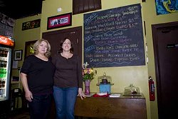 CATALINA KULCZAR-MARIN - ON BOARD: Lori Pearson (left) and Lisa Burris next to the day's food offerings at Savor Café & Catering.