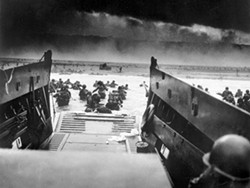 NATIONAL ARCHIVES - ON THE BEACH: The troops landing at Normandy, France, on June 6, 1944, as seen in The War