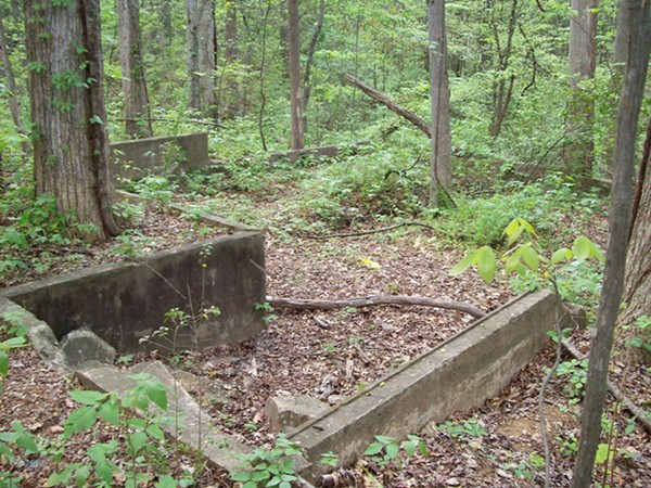 One of many World War I era structural foundations left behind on the grounds of Camp Greene Park.