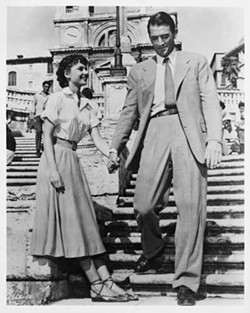 PARAMOUNT - ONE STEP AT A TIME: Ann (Audrey Hepburn) learns about life among the common people thanks to reporter Joe Bradley (Gregory Peck) in Roman Holiday.