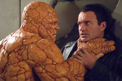 ORANGE CRUSH: Victor Von Doom (Julian McMahon) finds himself stuck between The Thing (Michael Chiklis) and a hard place in Fantastic Four: Rise of the Silver Surfer
