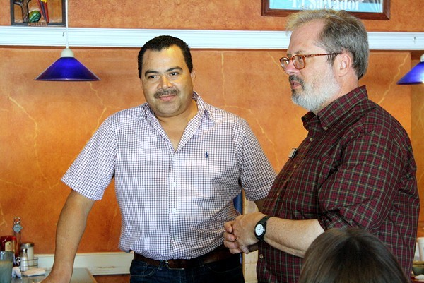Owner Henry Chirinos talks to the tour group with Dr. Tom Hanchett