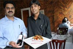 CATALINA KULCZAR - Owner Pannu Singh and waiter Pradip Ghimiri of Copper, Modern Indian Cuisine