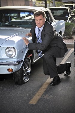 ROADSIDE ATTRACTIONS - PARKING LOT RAGE: Nick (Will Ferrell) tampers with his boss's car in Everything Must Go.