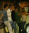 <p>PARTY OVER HERE: People waiting in line to enter an Uptown club</p>