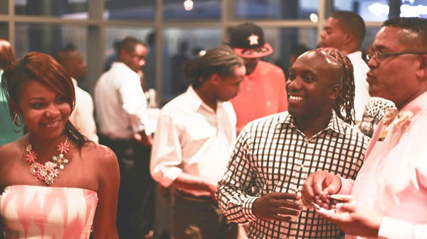 Patrons at the August edition of Charlotte's Favorite Happy Hour at the Gantt Center. - ENID VALU