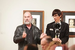 MERT JONES - Phil Moody, photography professor at Winthrop University, standing with Mitchell Kearney at an October meeting of the members of The Light Factory