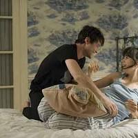 PILLOW TALK: Tom (Joseph Gordon-Levitt) and Summer (Zooey Deschanel) cozy up in (500) Days of Summer.