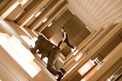 STEPHEN VAUGHAN / WARNER BROS. - PRANCING ON THE CEILING: Arthur (Joseph Gordon-Levitt, background) realizes the gravity of the situation in Inception.