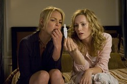 SUZANNE HANOVER / UNIVERSAL STUDIOS - PREGNANT WITH POSSIBILITIES Alison (Katherine Heigl, left) enlists the aid of her sister Debbie (Leslie Mann) to determine if she's with child in Knocked Up