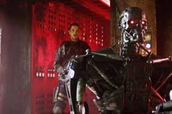 RICHARD FOREMAN / WARNER BROS. - PROCEED WITH CAUTION: John Connor (Christian Bale) sneaks up behind a T-600 Terminator in Terminator Salvation.