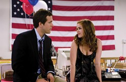ANDREW SCHWARTZ / UNIVERSAL STUDIOS - RED, WHITE AND WOO: Will (Ryan Reynolds) attempts to romance April (Isla Fisher) in Definitely, Maybe.