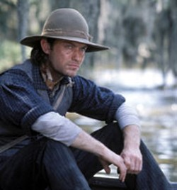 DEMMIE TODD/MIRAMAX - RIVER OF DREAMS Jude Law thinks of home in - Cold Mountain