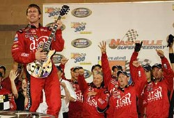 NASCARMEDIA.COM - ROCK-SCAR: Carl Edwards rocks out at the finish line in 2007.