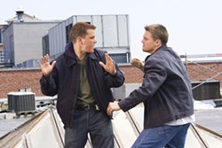 ANDREW COOPER / WARNER BROS. - ROOFTOP RUMBLE Undercover State Trooper Billy Costigan (Leonardo DiCaprio, right) confronts mob mole Colin Sullivan (Matt Damon) in The Departed.