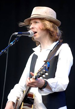 BONNAROO.COM - ROUGED Beck onstage at the 'Roo