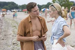 FRANCOIS DUHAMEL / PARAMOUNT VANTAGE - SAND AND TURF: Frank and April Wheeler (Leonardo DiCaprio and Kate Winslet) hope to escape from their suburban setting in Revolutionary Road.