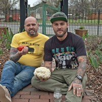Scott and Joey Linwell of Linwell Farms, with the NoDa Farmers Market site behind them.
