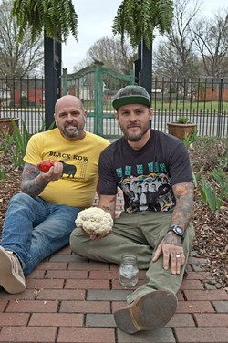MELISSA OYLER - Scott and Joey Linwell of Linwell Farms, with the NoDa Farmers Market site behind them.