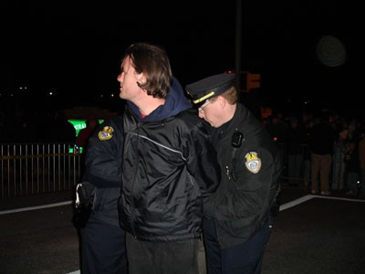 Scott Langley being arrested at the protest of the execution of Perrie Dyon Simpson
