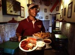 RADOK - Serving up wings and fries at Wing Stop