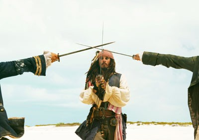 SHAKY SWORDPLAY Jack Sparrow (Johnny Depp) laments that it takes three to tangle in Pirates of the Caribbean: Dead Man's Chest